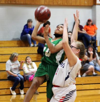 Forrest Murphy/Clifton Record/Morgan's Nia Aviles (10) and the Lady Eagles defeated JCSA, 54-19 Tuesday.