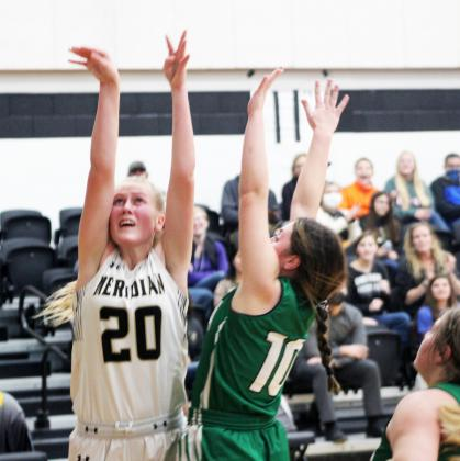 Forrest Murphy/Meridian Tribune/Meridian freshman Evelyn Dirkse (20) and the Lady Jackets fell to the Hamilton Lady Bulldogs, 68-9 Tuesday night.