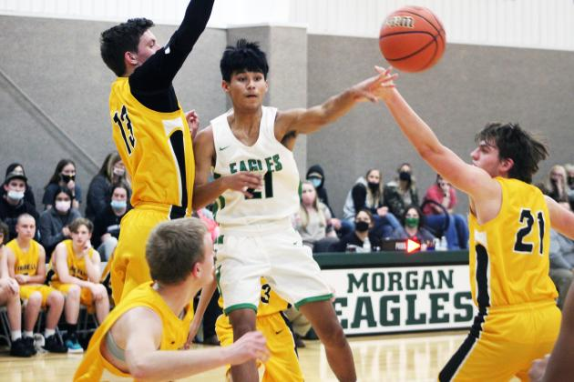 Forrest Murphy/Clifton Record/Morgan's Javier Guajardo (21) and the Eagles defeated the Iredell Dragons, 87-53 Tuesday.