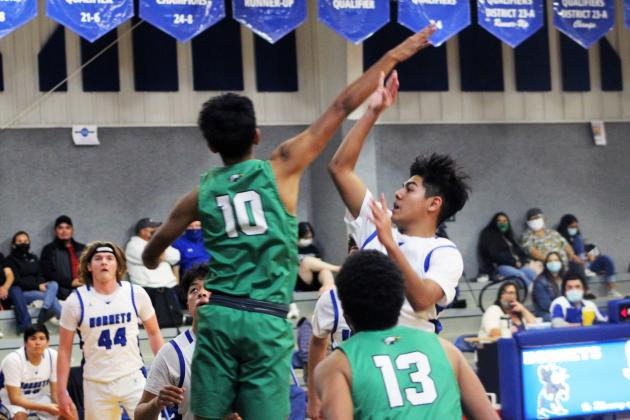 Forrest Murphy/Clifton Record/Walnut Springs' Diego Muniz (1) put up a team-high 20 points in his team's 50-42 win over the Covington Owls Tuesday night.