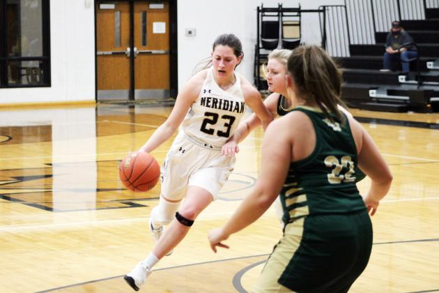Forrest Murphy/Meridian Tribune/Meridian junior Jaci Clifton (23) and the Lady Jackets closed out District 12-2A competition last week with a five-game stretch spanning Tuesday through Saturday.
