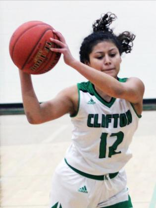 Bottom left: Clifton freshman Laylah Gaona (12) passes a ball to one of her teammates.